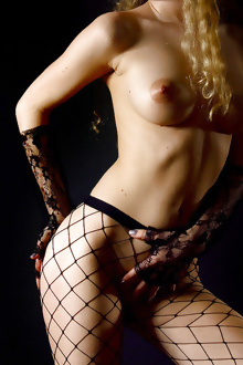 Curly blonde amateur Olia Baroque in erotic scene