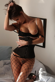 Jenni Lee in hot fishnets and black fetish corset